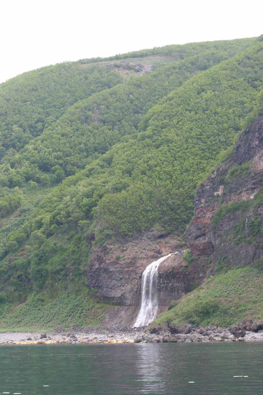 Context of the Kamuiwakka Waterfall's lowest tier as seen from the boat tour