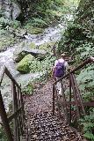 Shoji_Falls_063_10172016 - Dad descending steps as the Shoji Falls Trail weaved between and climbed over large boulders alongside the Ishiutoro River