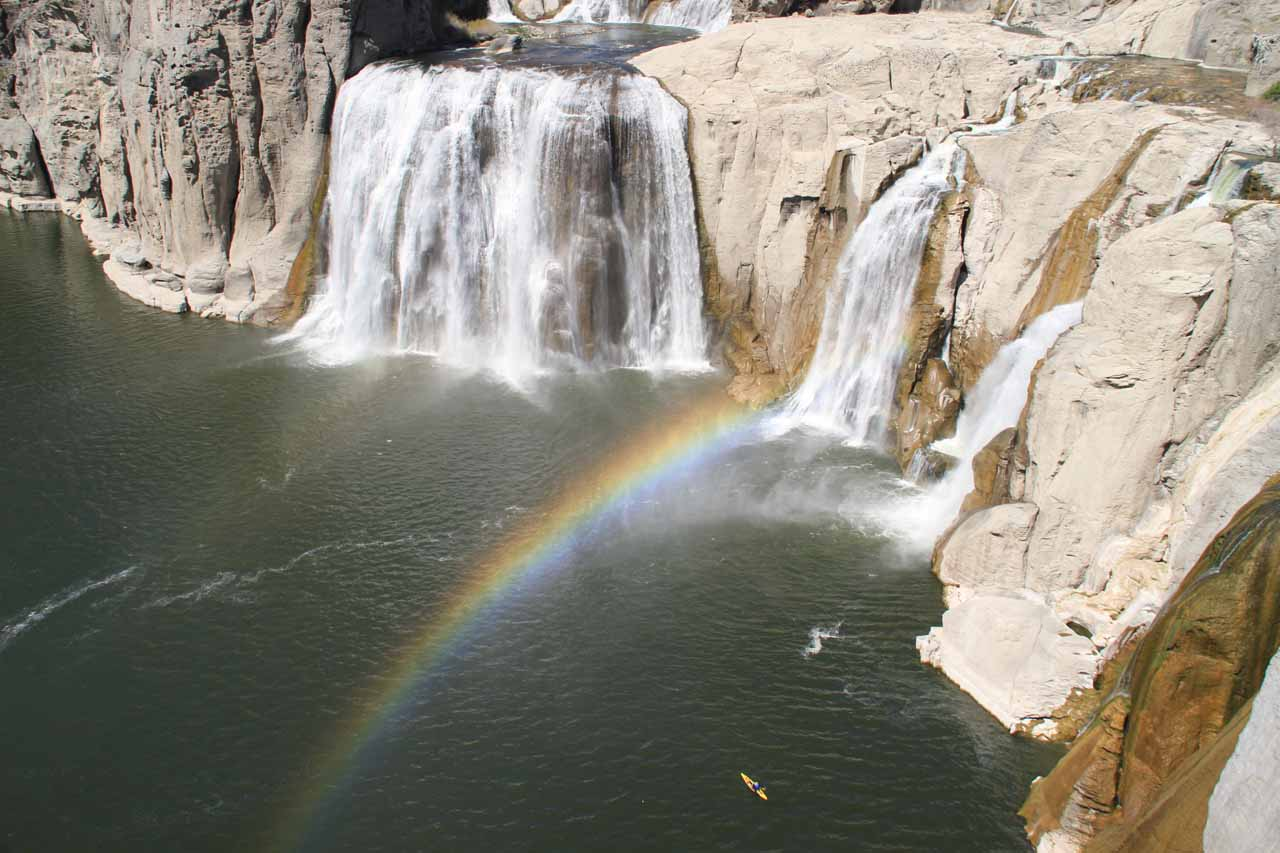 Closer look at Shoshone Falls with double rainbow and a kayaker for scale