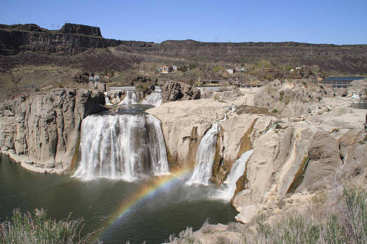 Shoshone Falls with butte in background and double rainbow in foreground