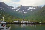 Siglufjordur_305_08142021 - Looking in the distance towards a cascade backing some buildings across the south side of the harbor from the Siglo Hotel