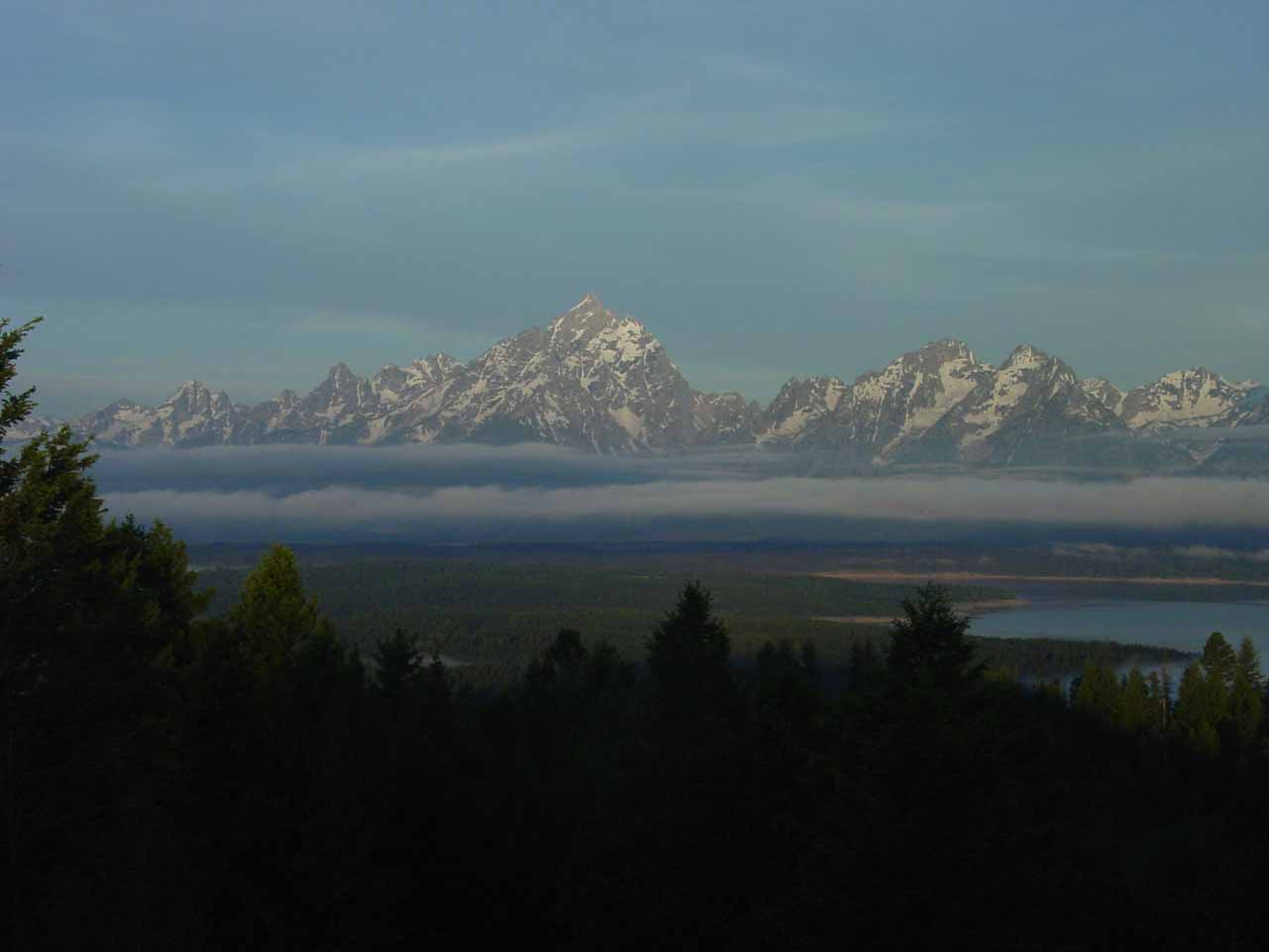 View of the Teton Range above the early morning fog from atop Signal Mountain