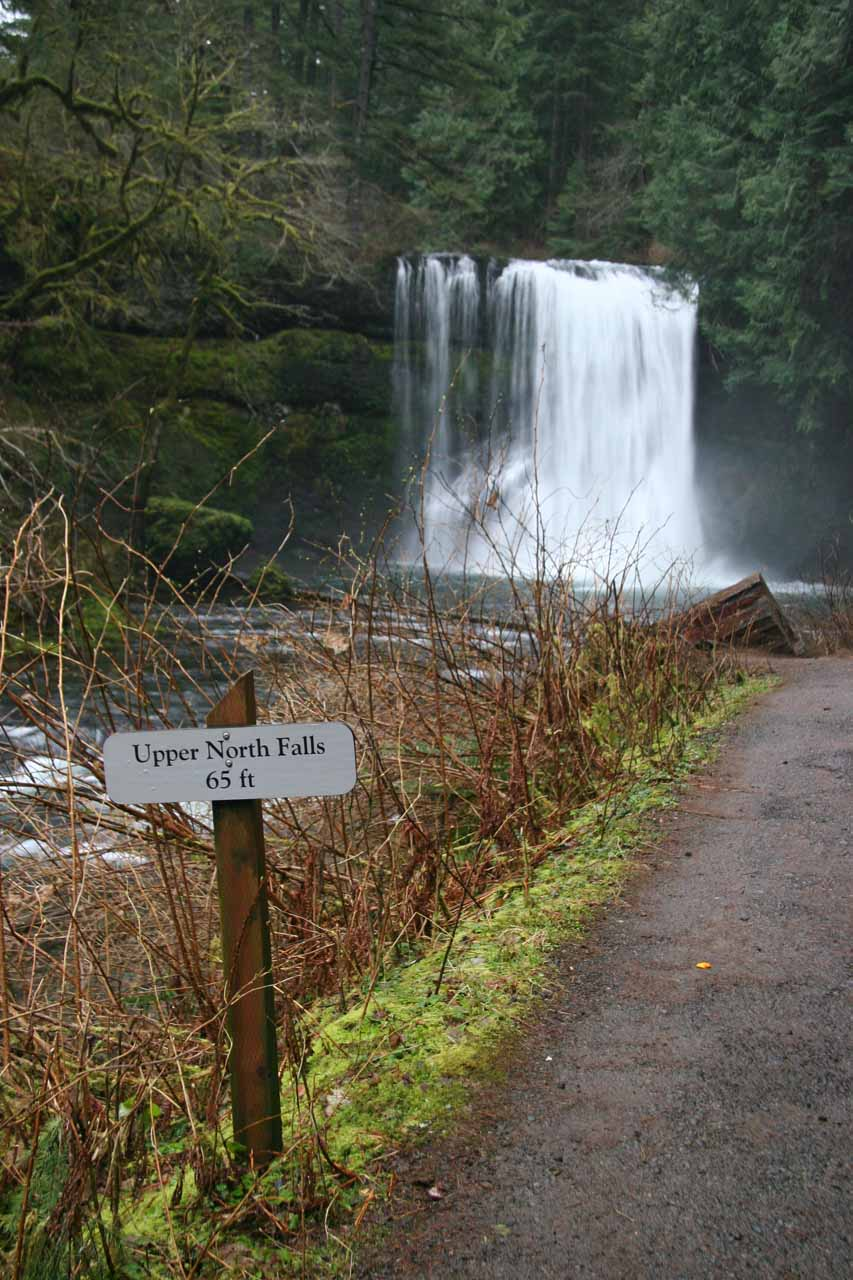 Passing by a sign indicating the height of Upper North Falls