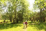 Silverfallet_018_06152019 - Julie and Tahia continuing to pass through an open clearing on the Silverfallet Trail