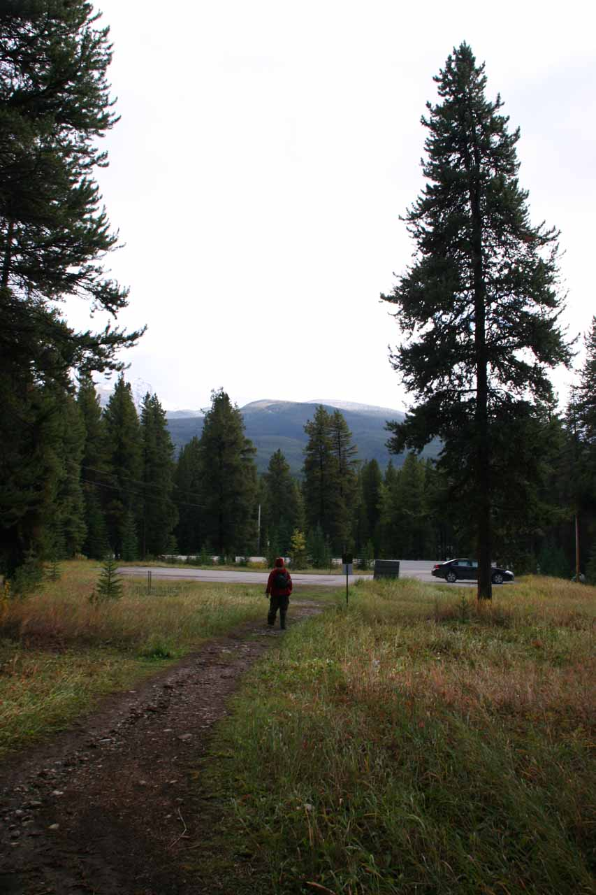 Julie returning to the car park for Rockbound Lake where our rental car was the last one here for the day
