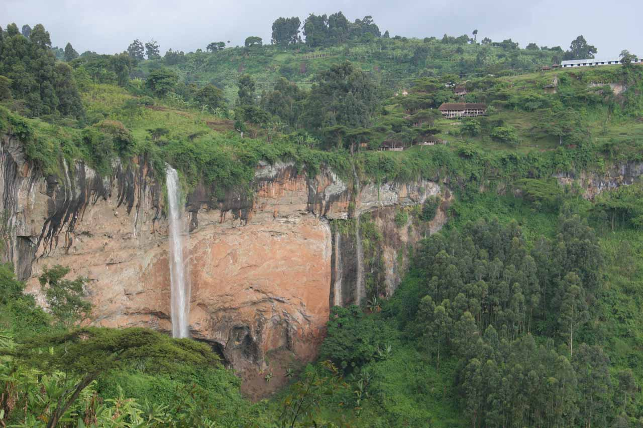 Looking back at the main Sipi Falls after ascending a steep path towards a small ledge and cave
