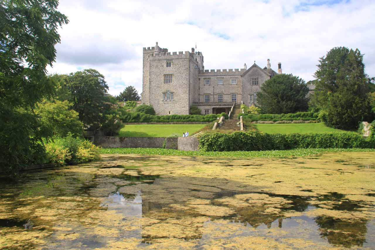 Reflections and lily pads in the pond behind the Sizergh Castle