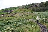 Sjavarfoss_007_08042021 - Mom approaching the semi-circular bridge fronting the ruins before Sjávarfoss during our 2021 visit