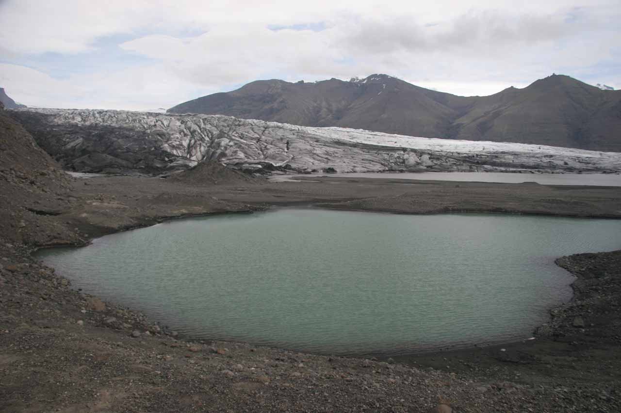 A small tarn near the terminus of the glacier Skaftafellsjökull