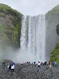 Skogafoss_004_iPhone_08072021 - Context of lots of people crowding the base of Skógafoss during our August 2021 trip. Compare this to our photos from July 2007 when there weren't nearly as many people around
