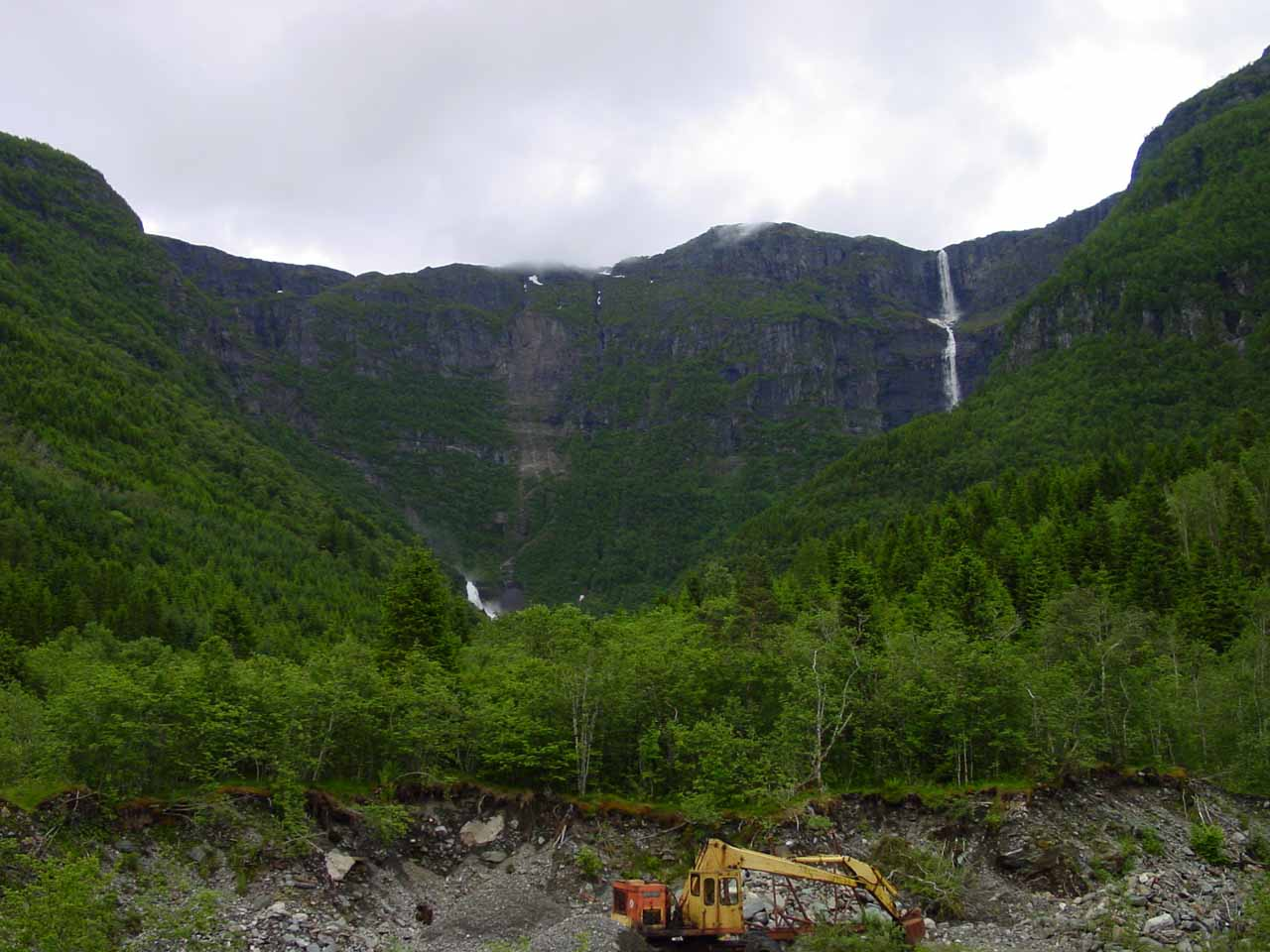 Looking past some construction vehicle towards both Skrikjofossen (right) and Opofossen (barely visible on the left)