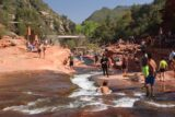 Slide_Rock_SP_076_04132017 - One person was entering the Slide Rock and about to scoot his way down to deeper waters further downstream on Oak Creek