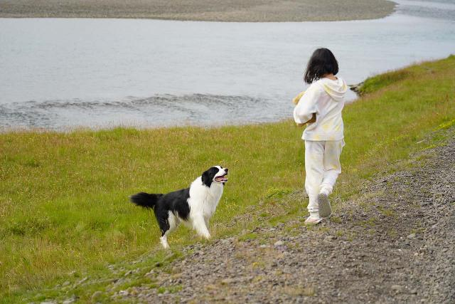 Snaedalsfoss_024_08092021 - Tahia, who's a big lover of dogs, enjoyed the company of the local dog that I'd imagine belongs to the Bragðavellir Farm. It kind of reminds me of the time when we were followed around by a local dog way out at Djúpavík in the Westfjords