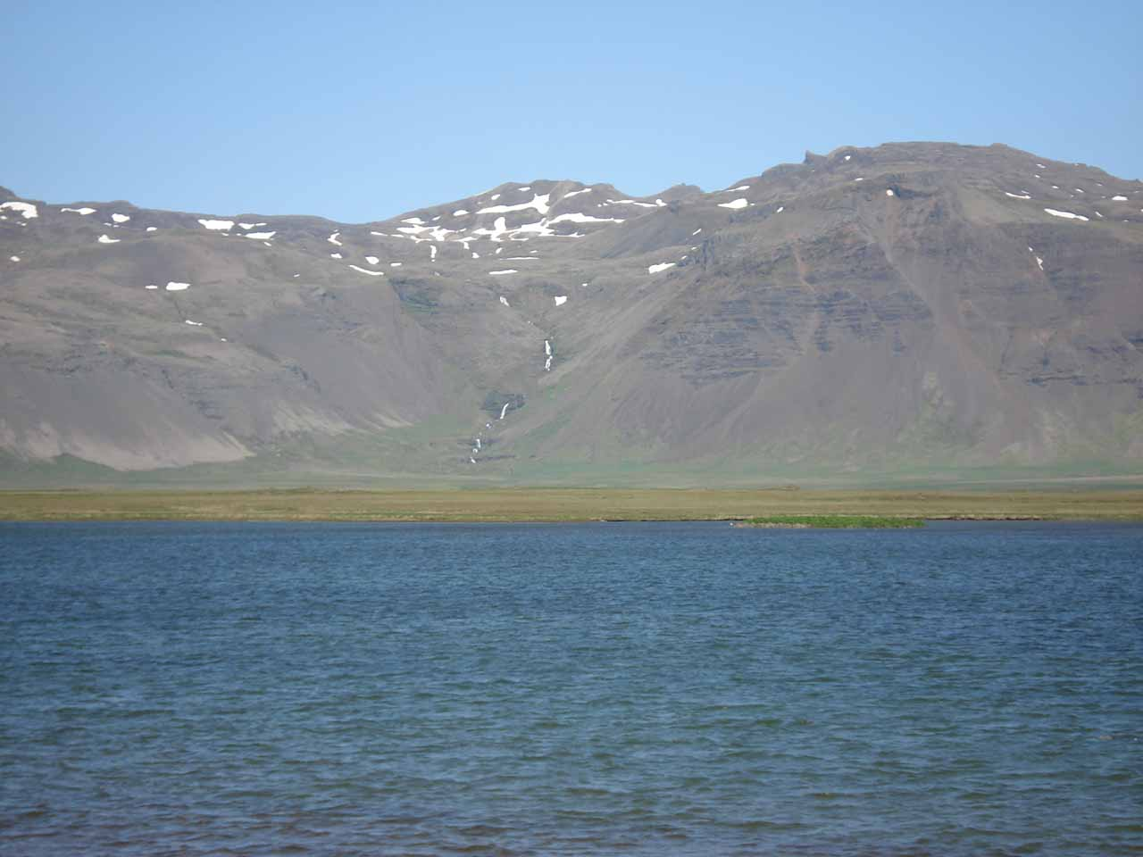 Looking across a lake towards another mountain cascade on the southern side of the Snæfellsnes Peninsula