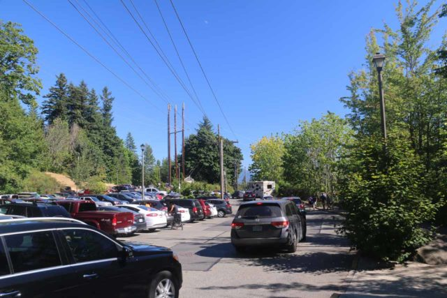Snoqualmie_Falls_17_002_07292017 - Lots of people circling around competing for parking spaces at the upper parking lot across the Hwy 202 from the Salish Lodge on a Saturday afternoon in the Summer of 2017