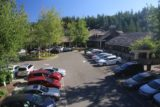 Snoqualmie_Falls_17_078_07292017 - Looking down towards the parking lot immediately in front of the Salish Lodge from the pedestrian footbridge in late July 2017