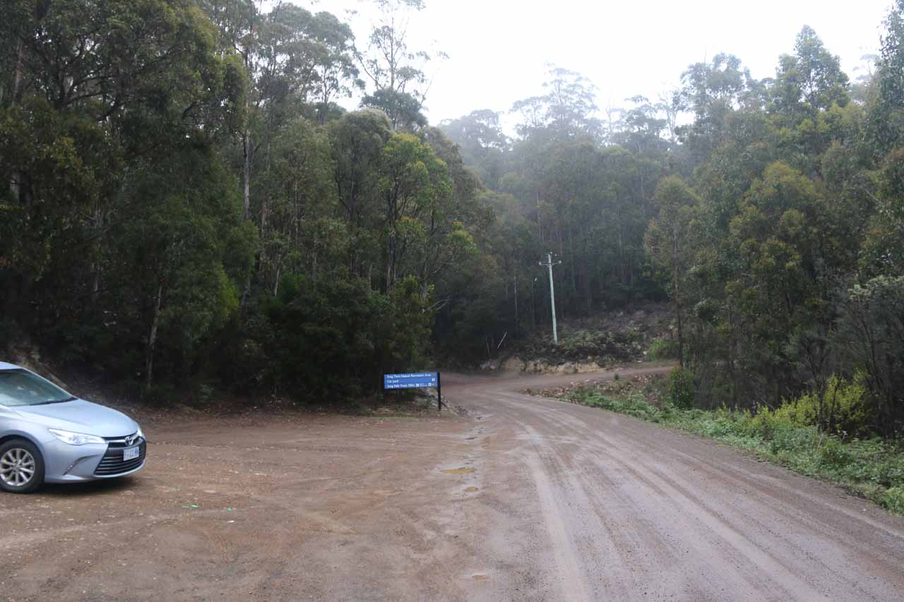 The car park next to the unsealed road about 150m before the Snug Falls trailhead