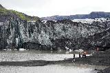 Solheimajokull_064_08072021 - More focused look at people standing before the terminus of the Solheimajokull Glacier terminus