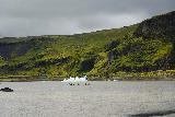 Solheimajokull_168_08072021 - Kayakers starting to make their way on the glacial lagoon among the icebergs at Solheimajokull