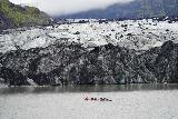 Solheimajokull_185_08072021 - Another look at kayakers getting closer to the terminus of the dirty ice of Solheimajokull