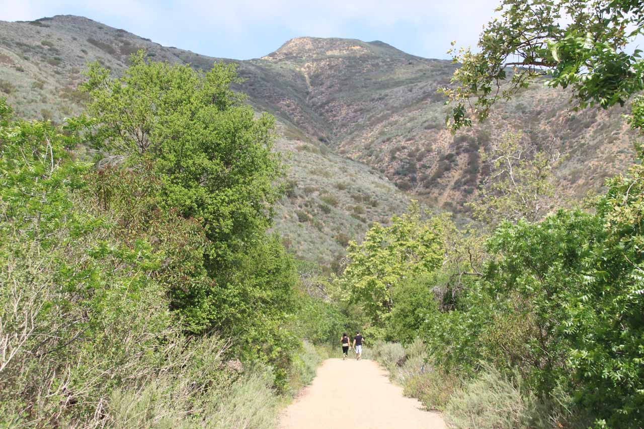 Other people zooming past us on a sun-exposed part of the Solstice Canyon Trail