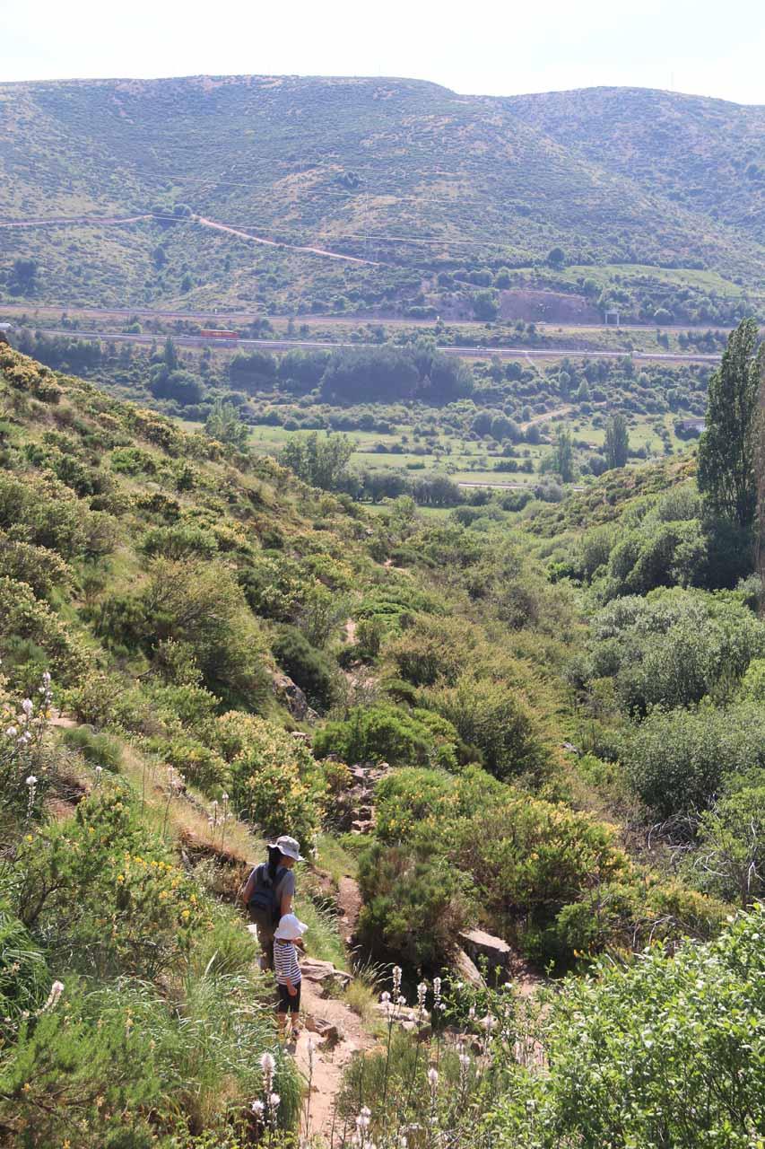 Looking back at Julie and Tahia leaving the Somosierra Waterfall