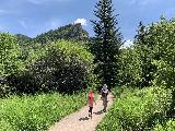 Spearfish_Canyon_030_iPhone_07302020 - Julie and Tahia passing through an open part of Spearfish Canyon en route to the base of Spearfish Falls