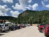 Spearfish_Canyon_114_iPhone_07302020 - Looking across the busy and rather competitive parking lot at the Latchstring and for Spearfish Falls