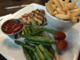 Spokane_007_iPhone_08042017 - The somewhat clean chicken and asparagus dish for Tahia at this place in the Riverfront Square Shopping Mall