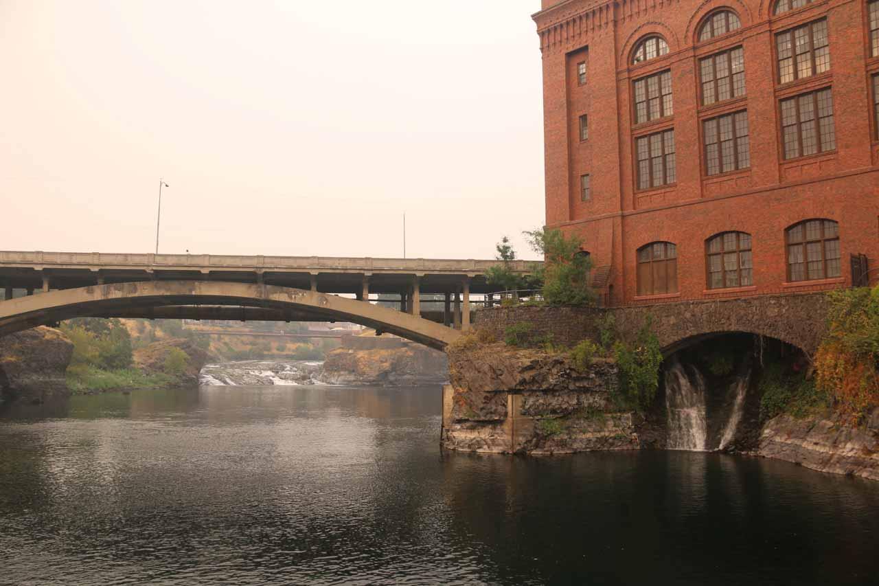 Looking upstream along the Spokane River beneath the North Post Street Bridge towards part of the Upper Spokane Falls