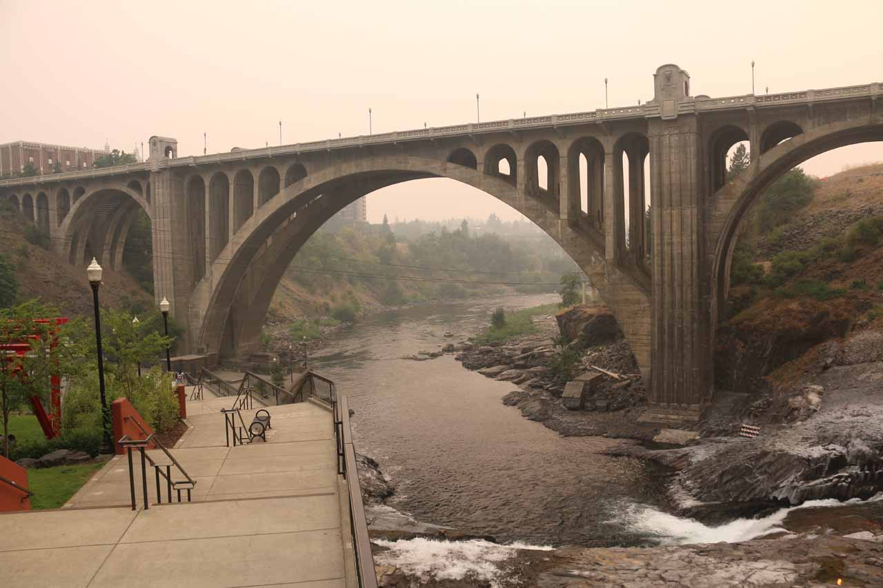 Walking down the steps alongside the Spokane River and Falls with the Monroe Street Bridge looming high up above