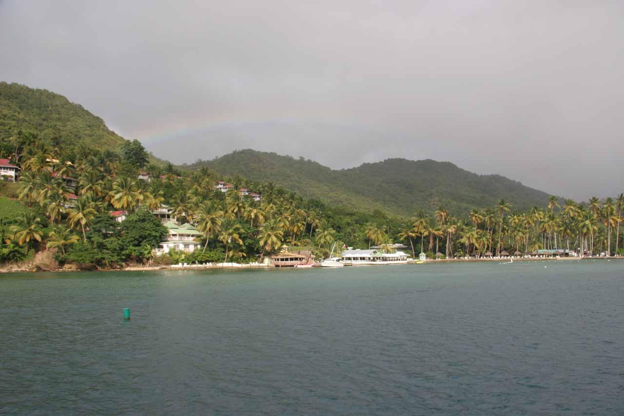 Rainbow over homes at Marigot Bay