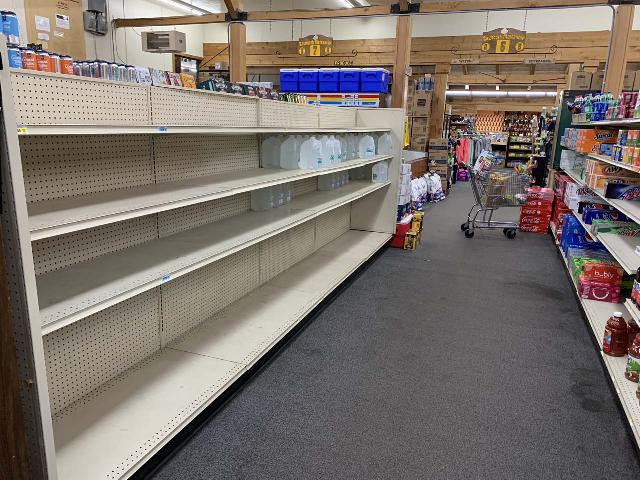 This was the empty water aisle at the store on a hot day in Central Idaho. The only water left were the distilled ones