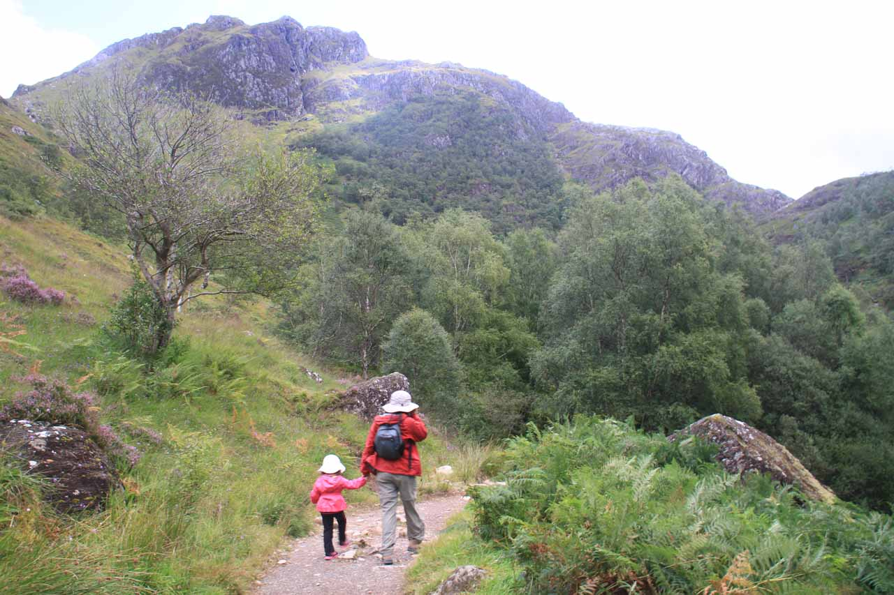 Julie and Tahia on the trail surrounded by the tall mountains flanking Glen Nevis and the Nevis Gorge