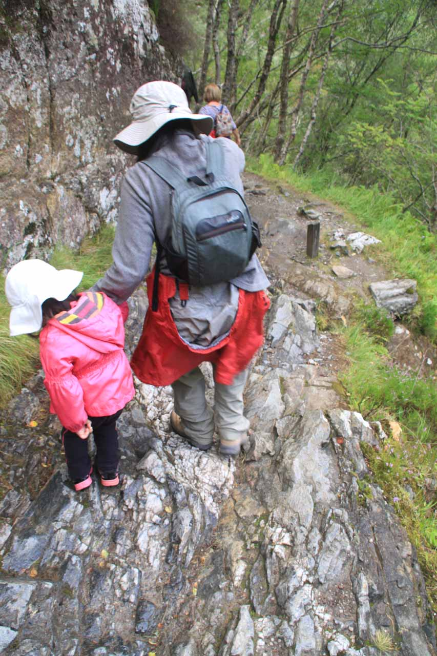 Julie helping Tahia past another tricky rocky section of the trail