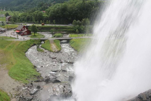 Steindalsfossen_051_06262019 - Looking down at Steinsdalsfossen during our 2019 visit from its backside. Notice on one of the photos in the photo gallery below how the car park and souvenir shop was on the opposite side of the bridge below than what's shown in this photo