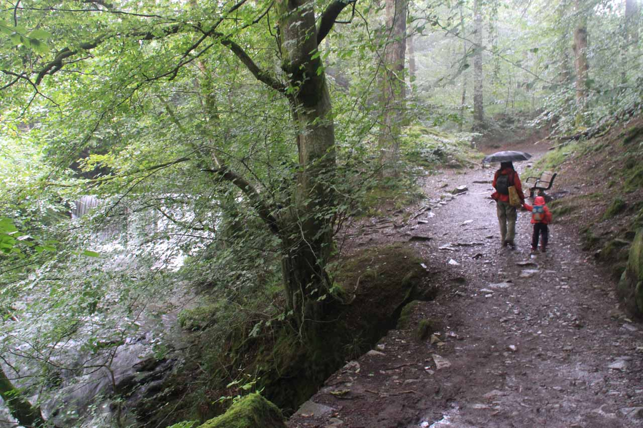 Julie and Tahia dealing with the rain while walking towards Stock Ghyll Force