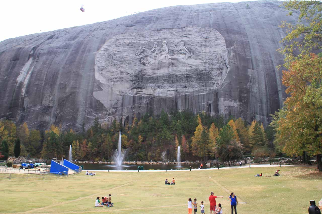 Stone Mountain and lawn area with artifacts of snow park being created