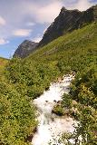 Storseterfossen_055_07182019 - Looking over the cascades upstream of Storseterfossen with Grinddalsnibba in the background