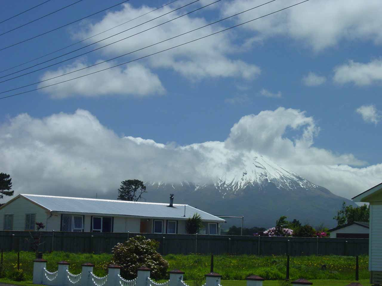 In our first visit to Dawson Falls, we drove from Stratford directly to the falls, where we got these partial views of the snow-capped Mt Taranaki along Opunake Rd