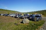 Studlagil_Canyon_048_08102021 - Looking back at the very busy car park within the Klaustursel Farm, which was the closest trailhead to get within Studlagil Canyon
