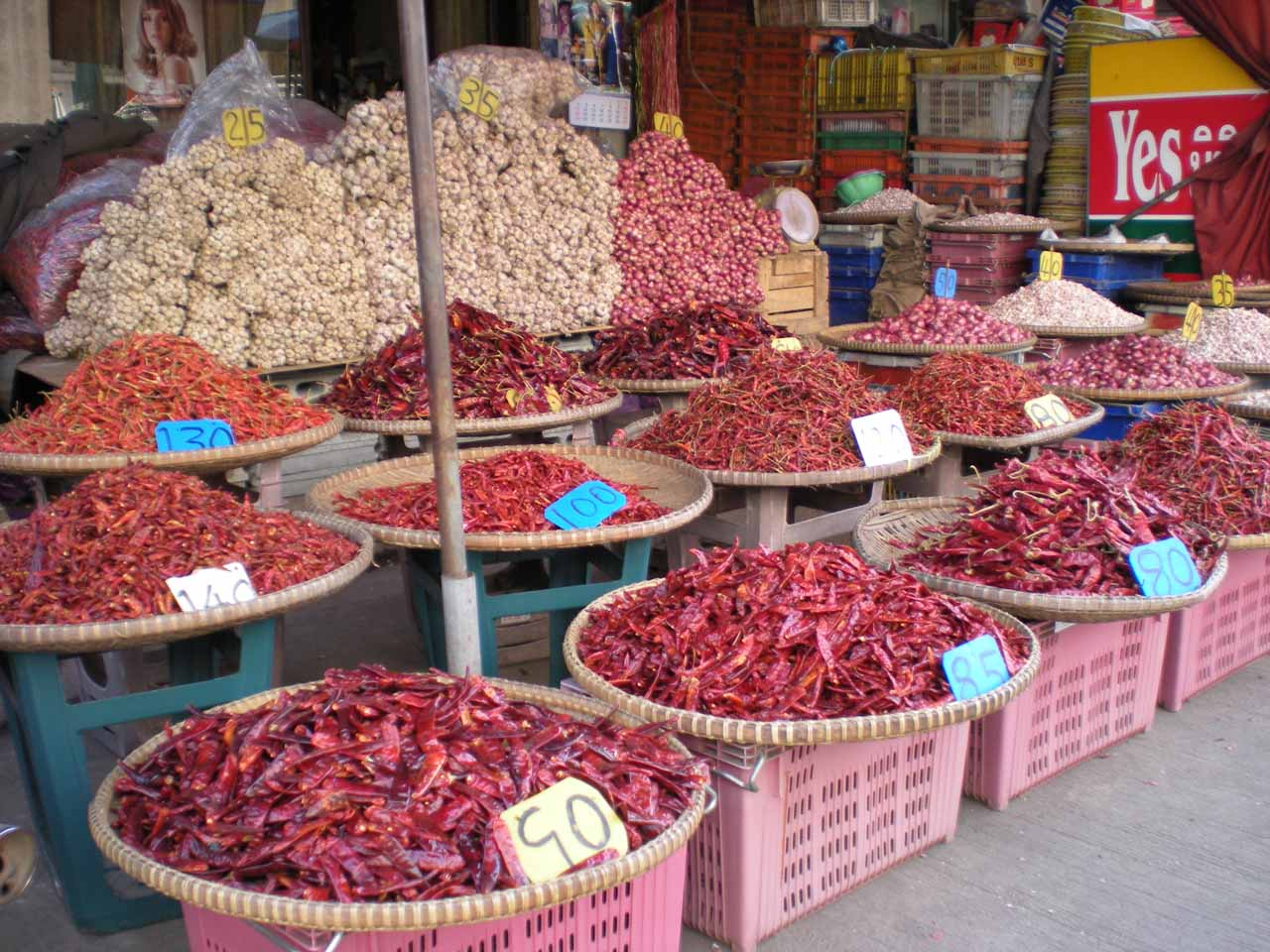 Local market with lots of colorful and I'm sure spicy chilis at Sukhothai