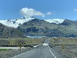 Svinafellsjokull_002_iPhone_08082021 - Driving across a single-lane bridge towards the blue Svinafellsjokull