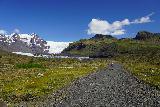 Svinafellsjokull_020_08082021 - Mom continuing towards the blue ice of the terminus of Svinafellsjokull