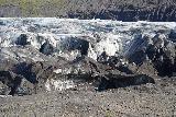 Svinafellsjokull_036_08082021 - Looking down towards people getting dwarfed by the dirty ice at the terminus of Svinafellsjokull