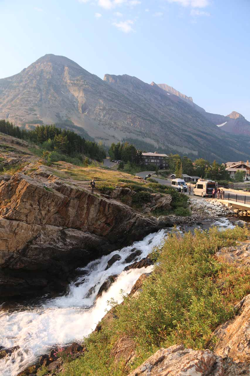 Contextual view of the uppermost drop of Swiftcurrent Falls as seen from an outcrop behind the private residence