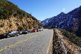 Switzer_Falls_004_12282019 - Looking east along the Angeles Crest Highway as some cars were parked along the road near the upper parking lot for Switzer Falls