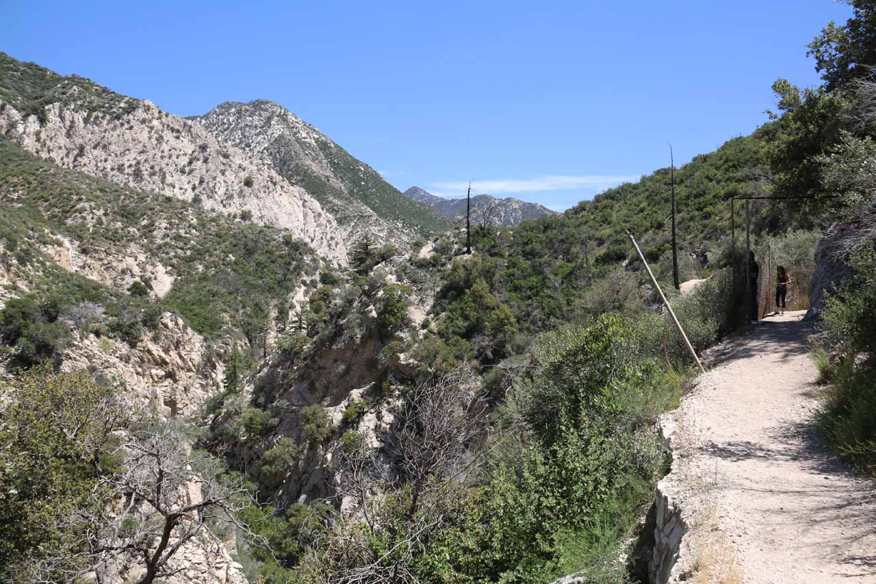 The cliff-exposed trail going around the steep canyon containing the main part of Switzer Falls and going towards a scenic trail junction at the trail's apex