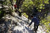 Switzer_Falls_112_12282019 - Continuing slowly on the scary scramble above the Lower Switzer Falls before getting to the ledge by the fallen tree