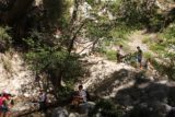 Switzer_Falls_184_04232016 - Looking back at some people scrambling back from a trail-of-use to get past the Lower Switzer Falls. This was where I had started the scramble up to the main drop of Switzer Falls during this April 2016 visit, but it was possible to do a more direct scramble further upstream to get onto the same ledge at the diciest part of the scramble